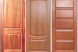 Двери из массива и шпона: какую установить?